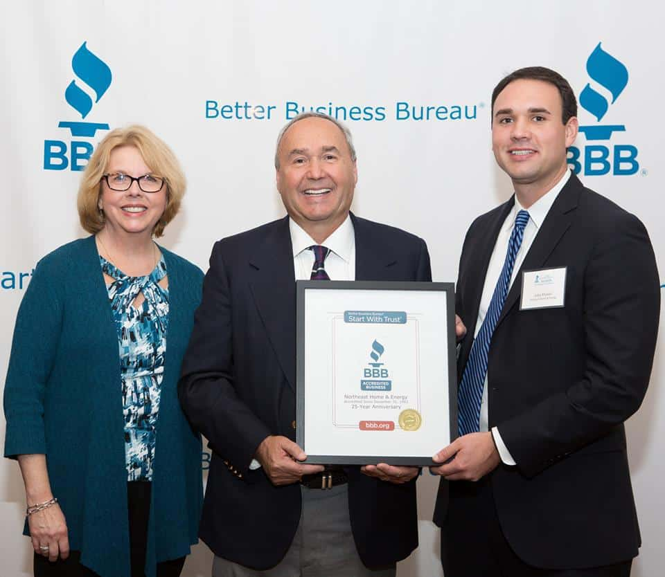 Richard and John Prunier receiving an award from the BBB