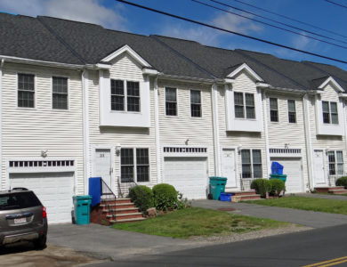 photo of a roof on townhouses in Upton MA replaced by Upton roofing contractor Northeast Home & Energy